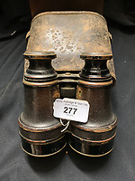 BNPS.co.uk (01202 558833)<br /> Pic: HAldridge/BNPS<br /> <br /> The binoculars Samuel Smith's used to search for bodies from the Titanic.<br />  <br /> A poignant cross made from drift wood from the Titanic by a seaman tasked with recovering the bodies from the disaster as surfaced 107 years later.<br /> <br /> The small religious symbol was delicately hand carved by Samuel Smith, a joiner on the cable-laying ship Minia which was tasked with searching for bodies.<br /> <br /> Mr Smith was so moved by the macabre experience that he honoured the victims by creating the wooden cross on a three-tiered plinth.<br /> <br /> He made it from a piece of oak wood he plucked from the ocean that has come from the sunken liner.<br /> <br /> The archive is estimated to sell for £35,000 at H Aldridge in Devizes.