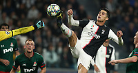 Football Soccer: UEFA Champions League -Group Stage-  Group D - Juventus vs Lokomotiv Moskva, Allianz Stadium. Turin, Italy, October 22, 2019.<br /> Juventus' Cristiano Ronaldo (r) in action with Locomotiv Moskva's goalkeeper Guilherme (l) during the Uefa Champions League football soccer match between Juventus and Lokomotiv Moskva at Allianz Stadium in Turin, on October 22, 2019.<br /> UPDATE IMAGES PRESS