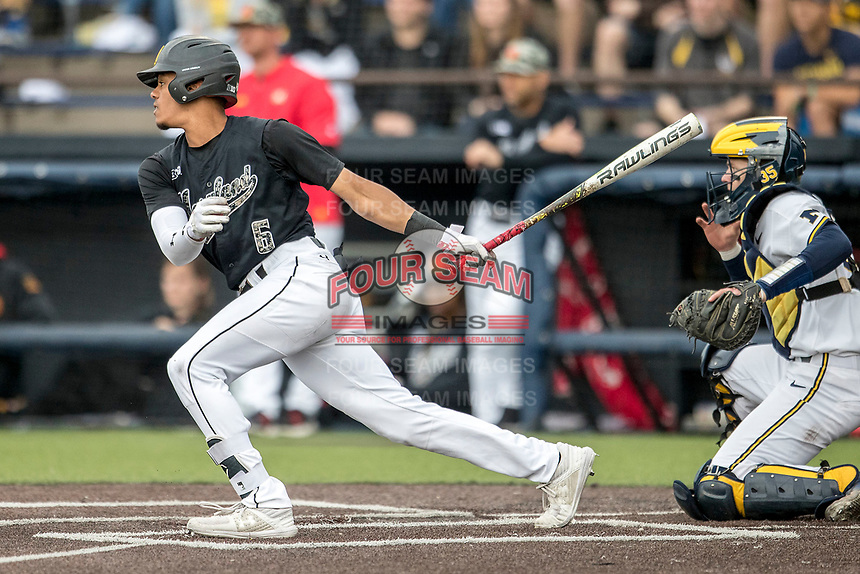Maryland Terrapins shortstop AJ Lee (6) follows through on his swing against the Michigan Wolverines on April 13, 2018 in a Big Ten NCAA baseball game at Ray Fisher Stadium in Ann Arbor, Michigan. Michigan defeated Maryland 10-4. (Andrew Woolley/Four Seam Images)