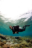 diver practising buoyancy in shallow water