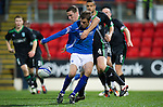 St Johnstone v Hibernian...26.11.11   SPL .Murray Davdison is tackled by Paul Hanlon.Picture by Graeme Hart..Copyright Perthshire Picture Agency.Tel: 01738 623350  Mobile: 07990 594431
