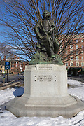 Nathaniel Hawthorne (1804-1864) statue in Salem, Massachusetts, USA during the winter months. Born in Salem, he is best known for The Scarlet Letter and The House of the Seven Gables.
