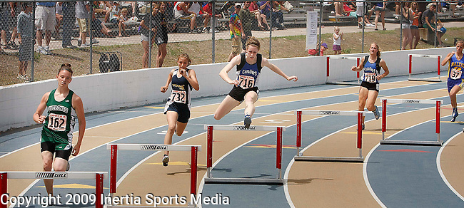 RAPID CITY, SD - MAY 30, 2009 :  Erin Duffy (center) leads during the 300 meter hurdle event at the 2009 South Dakota State High School Track and Field Meet in Rapid City Saturday. (Photo by Dick Carlson/Inertia)