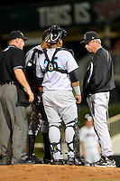 Jupiter Hammerheads pitching coach Joe Coleman #15 (right) talks with pitcher Jose Urena #34 behind catcher Wilfredo Gimenez #25 as umpire James Rackley listens in during a game against the Fort Myers Miracle on April 9, 2013 at Hammond Stadium in Fort Myers, Florida.  Fort Myers defeated Jupiter 1-0.  (Mike Janes/Four Seam Images)