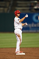 Memphis Redbirds shortstop Paul DeJong (11) gives a thumbs up to teammates after hitting a double during a game against the Round Rock Express on April 28, 2017 at AutoZone Park in Memphis, Tennessee.  Memphis defeated Round Rock 9-1.  (Mike Janes/Four Seam Images)