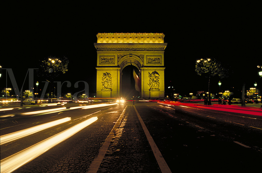 Arc de Triomphe at night with road leading to it. Paris, France. Paris, France.