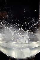 ICE DROPPED IN HOT WATER<br /> Crown of splash drops