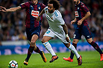 Marcelo Vieira Da Silva (c) of Real Madrid fights for the ball with Cristian Rivera Hernandez (l) of SD Eibar during the La Liga 2017-18 match between Real Madrid and SD Eibar at Estadio Santiago Bernabeu on 22 October 2017 in Madrid, Spain. Photo by Diego Gonzalez / Power Sport Images