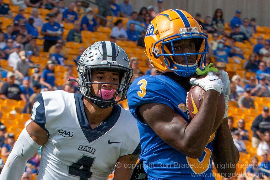 Pitt wide receiver Jordan Addison scores on a 46-yard touchdown reception despite the efforts of New Hampshire defensive back Randall Harris (4). The Pitt Panthers defeated the New Hampshire Wildcats 77-7 at Heinz Field, Pittsburgh, Pennsylvania on September 25, 2021.