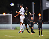 LAKE BUENA VISTA, FL - JULY 18: Giancarlo González #21 of LA Galaxy wins a header against Bradley Wright-Phillips #66 of LAFC during a game between Los Angeles Galaxy and Los Angeles FC at ESPN Wide World of Sports on July 18, 2020 in Lake Buena Vista, Florida.