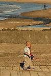 Boy with kite above Ballycastle Beach, Ballycastle, Northern Ireland