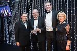 © Joel Goodman - 07973 332324 . 05/03/2015 .  Midland Hotel , Manchester , UK . L-R Eamonn O'Neill , winner Paul Schofield of Farleys Solicitors LLP , sponsor (DPS software) and Louise Straw . Crime Team of the Year . The Manchester Legal Awards 2015 . Photo credit : Joel Goodman