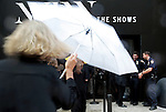 MANHATTAN, NY – SEPTEMBER 10, 2015: A crowd enters the 360 W. 33rd St. venue on a rainy first day of New York Fashion Week in Manhattan.