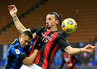 Football Soccer: Tim Cup Quarter Finals InternazionaleMIlan vs Milan, Giuseppe Meazza Stadium (San Siro) Milan, on January 26, 2021.<br /> Milan's Zlatan Ibrahimovic (r) in action with Inter's Alexis Sanchez (r) during the Italian Tim Cup football match between Inter  and Milan at the Giuseppe Meazza stadium in Milan, January 26, 2021.<br /> UPDATE IMAGES PRESS/Isabella Bonotto