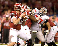 Cameron Heyward of Ohio State puts a lot of pressures on Arkansas quarterback Ryan Mallett during the game during 77th Annual Allstate Sugar Bowl Classic at Louisiana Superdome in New Orleans, Louisiana on January 4th, 2011.  Ohio State defeated Arkansas, 31-26.