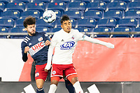 FOXBOROUGH, MA - OCTOBER 16: Ryan Spaulding #34 of New England Revolution II and Gibran Rayo #14 of North Texas SC compete for a high ball during a game between North Texas SC and New England Revolution II at Gillette Stadium on October 16, 2020 in Foxborough, Massachusetts.