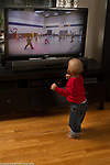 18 month old toddler boy dancing with video on TV
