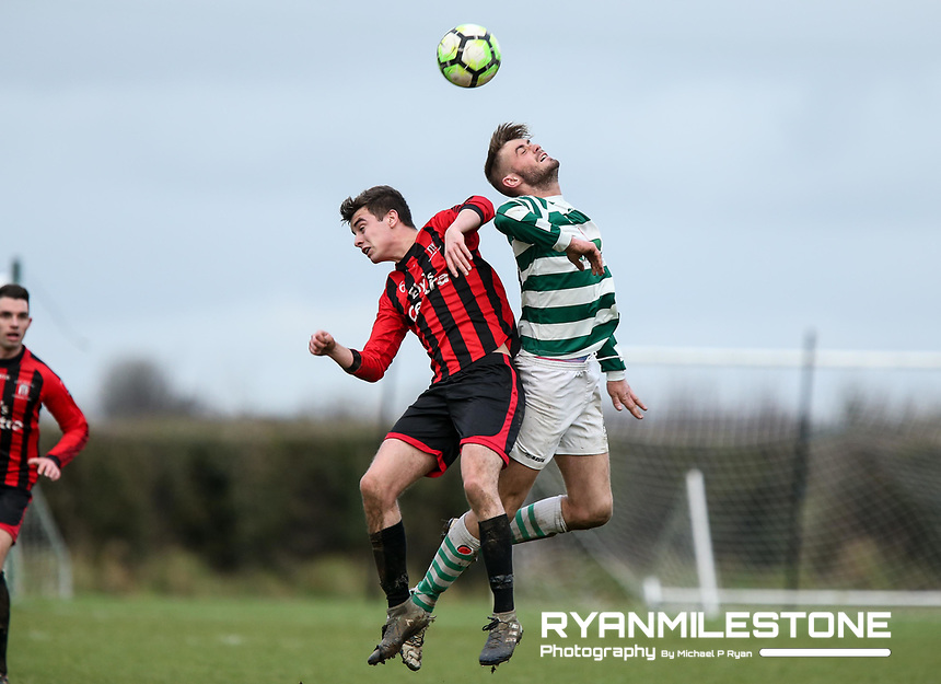 Michael Hynes of Nenagh in action against Peake Villa's Anthony Walker during the Munster Junior Cup 4th Round at Tower Grounds, Thurles, Co Tipperary on Sunday 28th January 2018, Photo By: Michael P Ryan