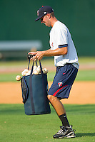 Pat Dean #46 of the Elizabethton Twins can't quite make it to the mound without losing some of the baseballs during batting practice at Joe O'Brien Field August 15, 2010, in Elizabethton, Tennessee.  Photo by Brian Westerholt / Four Seam Images