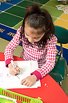 Education Elementary Kindergarten 5 or 6 year old girl drawing art activity