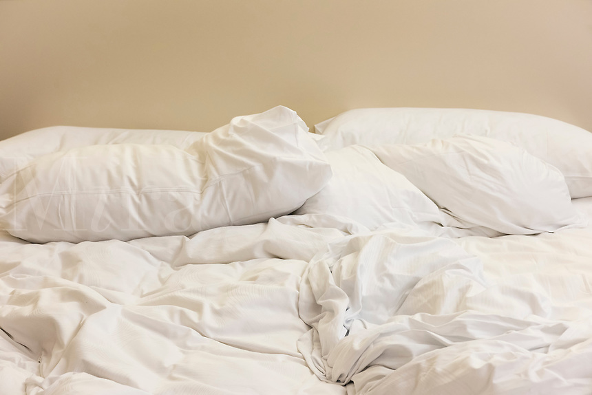 Unmade bed.