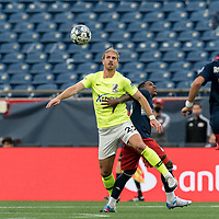 FOXBOROUGH, MA - MAY 12: Connor Doyle #22 of Union Omaha attempts to control the ball as Michel #48 of New England Revolution II defends during a game between Union Omaha and New England Revolution II at Gillette Stadium on May 12, 2021 in Foxborough, Massachusetts.