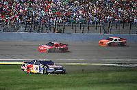 Oct. 4, 2009; Kansas City, KS, USA; NASCAR Sprint Cup Series driver Brian Vickers (83) spins as Tony Stewart (14) and Joey Logano (20) pass during the Price Chopper 400 at Kansas Speedway. Mandatory Credit: Mark J. Rebilas-