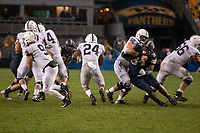 Penn State running back Miles Sanders goes through a hole created by a block by center Michal Menet on Pitt defensive lineman Amir Watts (34). The Penn State Nittany Lions defeated the Pitt Panthers 51-6 on September 08, 2018 at Heinz Field in Pittsburgh, Pennsylvania.