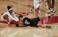 Arkansas' Makayla Daniels struggles for the ball with Texas A&M's Jordan Nixon Sunday Jan. 10, 2021 at Bud Walton Arena in Fayetteville. Arkansas lost 74-73. Visit nwaonline.com/210111Daily/ and nwadg.com/photos. (NWA Democrat-Gazette/J.T. Wampler)