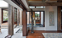 Post + Beam House, inspired by the interior framework of a traditional Japanese farmhouse. Large gliding doors and windows tie the inside and out together. Laura DuCharme Conboy, architect. Photographer Martin Mann