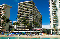 Close-up of hotels and people on the beach from a sailboat off Waikiki.