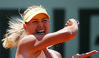 Maria Sharapova of Russia returns against Andrea Petkovic of Germany in the quarter final match of the French Open tennis tournament in Roland Garros stadium in Paris, Wednesday June 1, 2011. (foto: Srdjan Stevanovic/Starsportphoto ©)