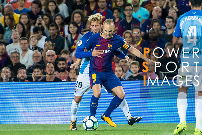 Andres Iniesta Lujan (r) of FC Barcelona competes for the ball with Sergio Gontan Gallardo, Keko, of Malaga CF during the La Liga 2017-18 match between FC Barcelona and Malaga CF at Camp Nou on 21 October 2017 in Barcelona, Spain. Photo by Vicens Gimenez / Power Sport Images