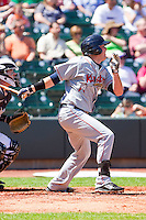 Chase Burnette #12 of the Kinston Indians follows through on his swing against the Winston-Salem Dash at BB&T Ballpark on April 17, 2011 in Winston-Salem, North Carolina.   Photo by Brian Westerholt / Four Seam Images