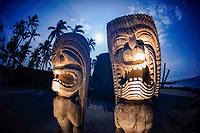 protector statues, Kii or Tiki, with full moon over Hale O Keawe, a heiau, Puuhonua o Honaunau National Historical Park, Honaunau, Big Island, Hawaii, USA