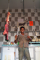 Smiling young male employee of a the butcher's shop, Quoseir Village, Red Sea, Egypt.
