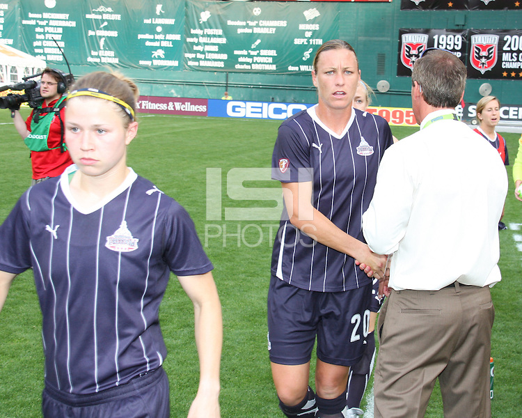Rebecca Moros #19, Abby Wambach #20 and coach Jim Gabarra of the Washington Freedom during a WPS match against ST. Louis Athletica on May 1 2010, at RFK Stadium, in Washington D.C. Freedom won 3-1.