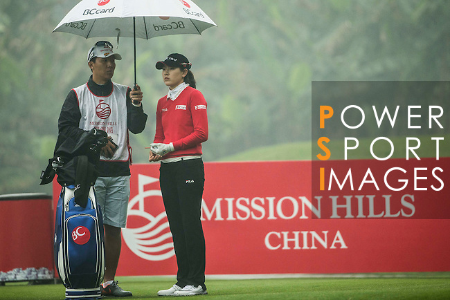Jung Min Lee of South Korea tees off at the 13th hole during Round 4 of the World Ladies Championship 2016 on 13 March 2016 at Mission Hills Olazabal Golf Course in Dongguan, China. Photo by Victor Fraile / Power Sport Images