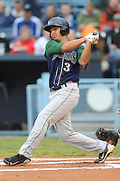 Lexington Legends Jiovanni Mier  #3 swings at a pitch during a game against  the Asheville Tourists at McCormick Field in Asheville,  North Carolina;  April 15, 2011.  Asheville defeated Lexington 2-1.  Photo By Tony Farlow/Four Seam Images