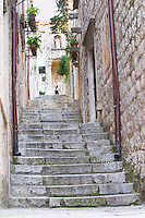 A narrow street leading up with steep steps Dubrovnik, old city. Dalmatian Coast, Croatia, Europe.