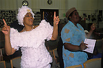 Halibethian Church,'based upon the principles of Christ', members of the congregation perform a spiritual dance and sing during the enthronement of Bishop Barrington Young. Harlesden north west London.