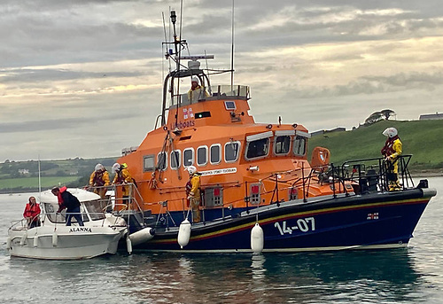 Courtmacherry RNLI's all-weather lifeboat and the pleasure boat with engine failure arrive safely into Courtmacsherry Harbour | Credit: RNLI/Courtmacsherry