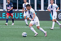 FOXBOROUGH, MA - JULY 4: Allen Gavilanes #23 of Greenville Triumph SC brings the ball forward during a game between Greenville Triumph SC and New England Revolution II at Gillette Stadium on July 4, 2021 in Foxborough, Massachusetts.