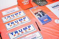Trump campaign hats, buttons, stickers, and signs in a campaign office in Salem, New Hampshire, on Fri., Sept. 18, 2020. A crowd gathered to celebrate the opening of this campaign office and to listen to former 2016 Trump campaign manager and current 2020 Trump campaign senior advisor Corey Lewandowski, who lives in nearby Windham, NH. It was also Lewandowski's birthday, and the campaign had a cake for him that was decorated to look like a 2020 Trump/Pence campaign sign.