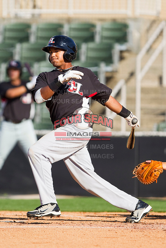 Teodoro Martinez #4 of the Hickory Crawdads follows through on his swing against the Kannapolis Intimidators at Fieldcrest Cannon Stadium on April 17, 2011 in Kannapolis, North Carolina.   Photo by Brian Westerholt / Four Seam Images