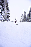 Snowboarder Emma Shapera riding Solitude Mountain on a powder Christmas Day.