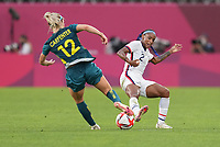 KASHIMA, JAPAN - JULY 27: Alanna Kennedy #14 of Australia battles with Crystal Dunn #2 of the United States before a game between Australia and USWNT at Ibaraki Kashima Stadium on July 27, 2021 in Kashima, Japan.