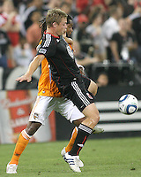 Danny Allsopp #9 of D.C. United  battles for the ball with Adrian Seioux #51of the Houston Dynamo during an MLS match at RFK Stadium in Washington D.C. on September  25 2010. Houston won 3-1.
