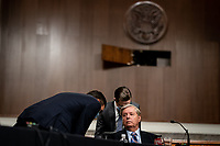 United States Senator Lindsey Graham (Republican of South  Carolina), Chairman, US Senate Judiciary Committee confers with aides during a US Senate Judiciary Committee business meeting to consider authorization for subpoenas relating to the Crossfire Hurricane investigation and other matters on Capitol Hill in Washington, DC on June 11, 2020. <br /> Credit: Erin Schaff / Pool via CNP/AdMedia