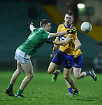 Cillian Brennan of Clare  in action against Brian Fanning of Limerick during the Mc Nulty Cup U-21 final at The Gaelic Grounds. Photograph by John Kelly.